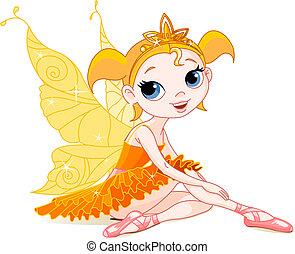 Little orange fairy ballerina sitting on a floor. All ...