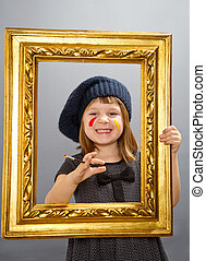 little painter girl looking through a vintage picture frame