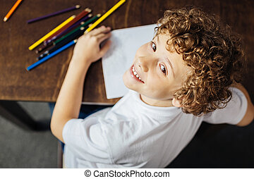 Little painter looking into camera and smiling