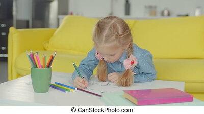 Little painter with felt tp pen drawing artwork - Positive...