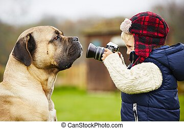 Little photographer - Little boy with camera is shooting his...