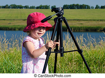 Little Photographer with Professional Tripod, River Background,  Outdoor