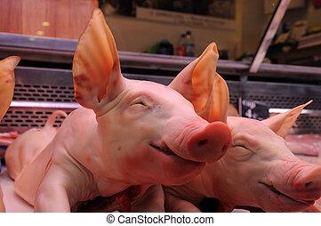 Little pigs for sale in La Boqueria market, Barcelona Spain