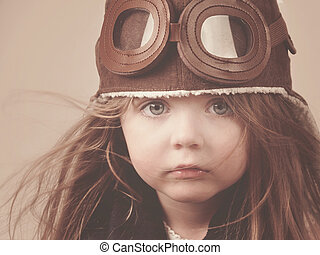 Little Pilot Girl with Hat - A little girl is wearing a...