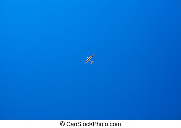 Little plane in the blue sky