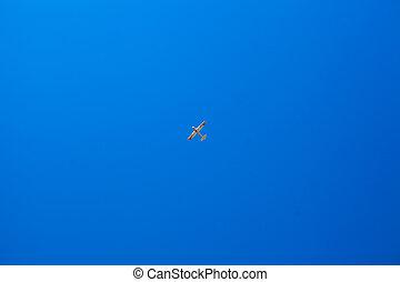 Little plane in the blue sky