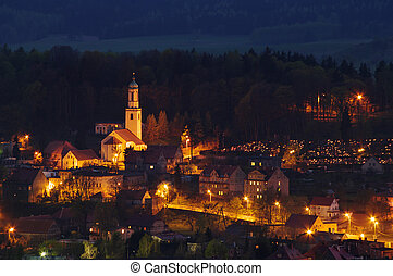 Little polish village in the hills during the twilight
