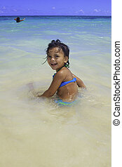 little Polynesian girl at the beach