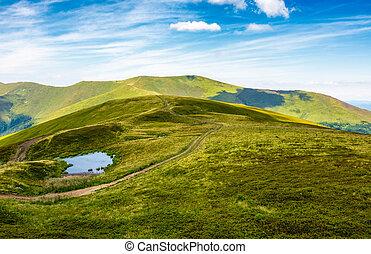 little pond on top of mountain ridge. gorgeous summer...