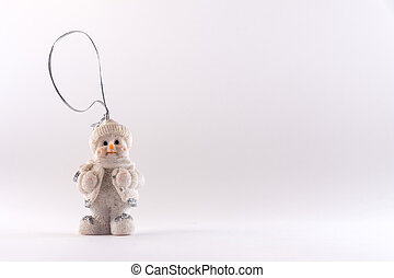 Little porcelain figurine on a white background