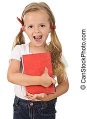Little preschool girl holding books