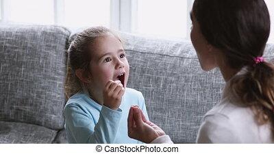 Little preschool kid girl learning right sounds ...