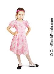Little pretty girl in beautiful pink dress