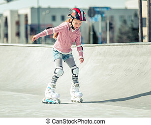 Little pretty girl on roller skates