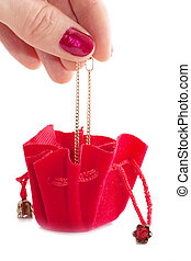 Little red bag - A female hand put golden chain into little ...