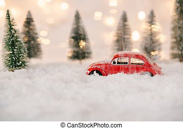 Little red car toy stuck in snow. - Little red car toy stuck...