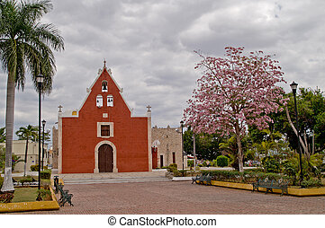 Very old little red church in Merida, Yucatan, Mexico