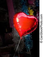 Little red color heart shape balloon in bazaar