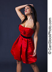 Little red dress - Woman with long dark hair in a red...