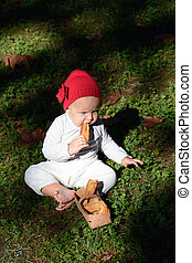 little red riding hood: a tiny girl sits in the forest