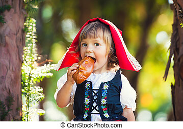 Little Red Riding Hood bites a patty in the forest.