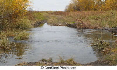 Water flows in a small river