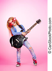 little rock star - Modern seven year old girl with her ...