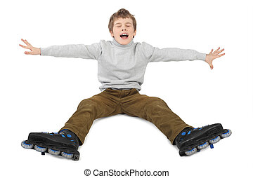 little roller boy sitting with hands moved at sides and crying isolated on white