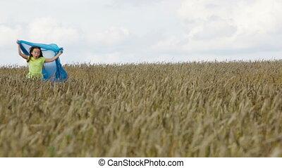 Little romantic - Cute little girl running across the field...