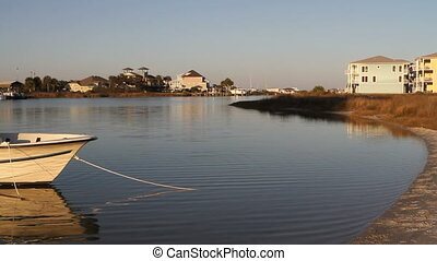 Little Sabine Bay - Water ripples around a small boat...