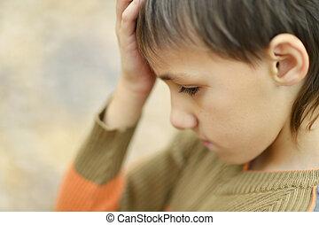 Little sad boy - Portrait of a happy little sad boy in ...