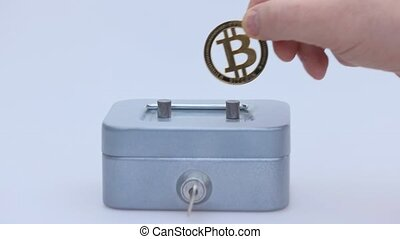 Little saving vault with golden bitcoin coin virtual money. Cryptocurrency, business and saving concept. High quality photo
