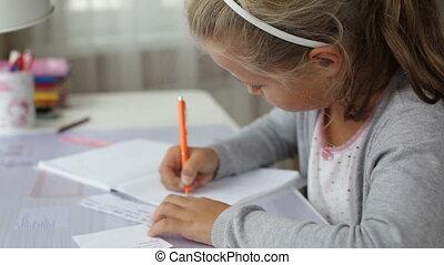 Little school girl doing homework