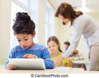 little school girl with tablet pc over classroom -...