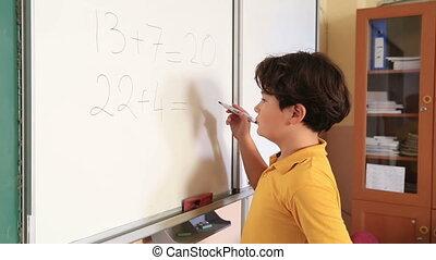 Little schoolboy solving problem - Little schoolboy solving...