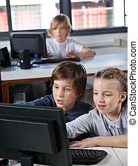 Little Schoolchildren Looking At Computer Monitor