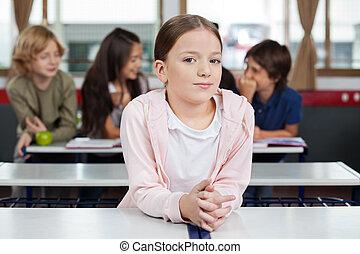 Little Schoolgirl Leaning At Desk