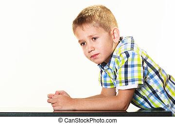 Little serious boy child