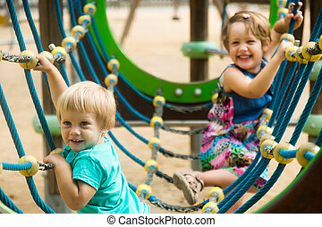 little sisters at action-oriented playground - little...