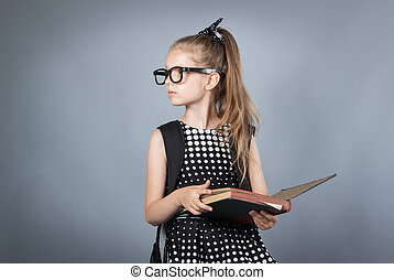 little smart girl reading a book