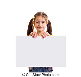 Little smiling girl looking in camera and holding white paper banner