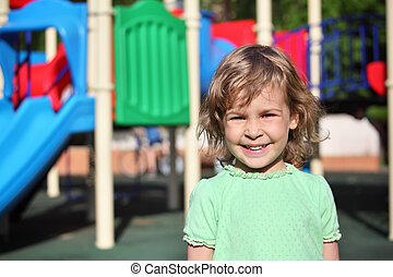 Little smiling girl on playground