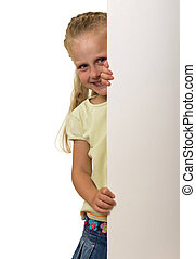 Little smiling girl peeks out from behind the banner, isolated on white