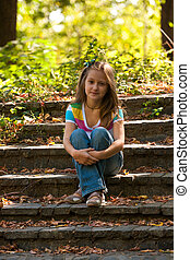 girl sitting on a stairs