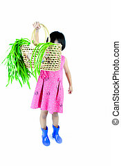 little smiling girl with a basket of vegetables on white background