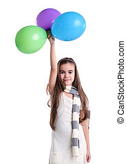 Little smiling girl with balloons