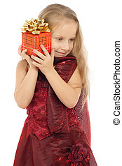 Little smiling girl with gift box, isolated on white