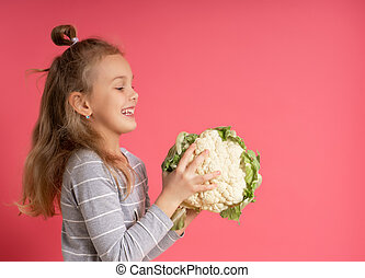 little smiling girl with head of cauliflower