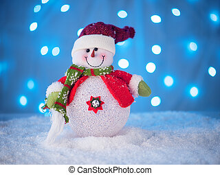 little snowman toy on a New Year's backgrou