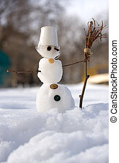 little snowman with broom